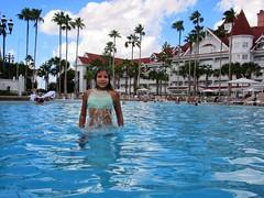 Refresh! Unwind! It's mid summer! (PointOfUPhotography) Tags: blue aqua refreshing pool splash midsummer summer palmtrees cloud sky architecture grandfloridian