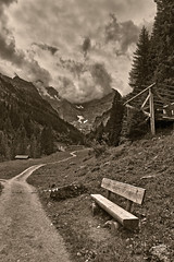 The Lonely Bench near Gimmelwald , ( Murren, Canton of Berne Switzerland ). No. 624. (Izakigur) Tags: swiss switzerland myswitzerland lasuisse laventuresuisse dieschweiz d700 nikond700 nikkor2470f28 thelonelybench alps alpen alpes suiza suizo suisia suïssa summer 2017 murren blackwhite izakigur berneroberland bern berne berna ch cantonofbern kantonbern topf25 100faves 500faves