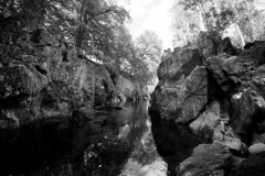 Gorge (M2161327 1x1x5 E-M1ii 8mm iso250 f4 1_60s) (Mel Stephens) Tags: widescreen 8mm fisheye bw silver efex black white ptgui 20170716 201707 2017 q3 rocks solitude river north esk aberdeenshire scotland uk water landscape olympus omd em1ii ii m43 microfourthirds mirrorless mzuiko pro best mft july wide wallpaper screensaver