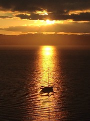 Floating in the light (Dove*) Tags: reflection sunset scotland knoydart sea