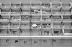 le havre (zebilibouba) Tags: pentax me ilford hp5 villette paris 19 building brutal umbrella bw nb balcony balcons flats home pentaxmeilfordhp5