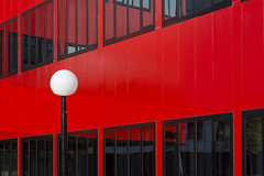 Red building with bulb lamp (on Explore) (Jan van der Wolf) Tags: map17224v rood redrule redoffice building gebouw office red lamp light bulb bol architecture architectuur hoofddorp reflection spiegeling