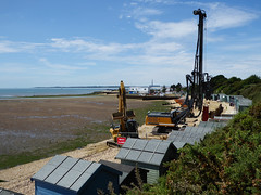 Seawall Works (Gilder Kate) Tags: hillhead hampshire piledriver seafront beachhuts works promenade new seawall digger beach panasoniclumixdmctz70 panasoniclumix panasonic lumix dmctz70 tz70