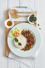 Rice topped with stir-fried pork and basil. (Phanuphong Thepnin) Tags: rice pork basil fried stir topped food thai background white spicy red healthy traditional hot meal delicious asian tasty asia eat vegetable cooking lunch chili cuisine restaurant dish thailand plate table stirfried famous fresh