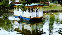 A travessia... MCris (MCrissssss) Tags: water reflexos água lagoarodigodefreitas paisagem travessia clube embarcação photo