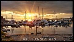Holidays (clamato39) Tags: burlington usa étatsunis soleil coucherdesoleil sun sunset marina sky clouds ciel bateau boat orange eau water