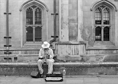 (frscspd) Tags: 43770011 20170311 pentax pentaxmx mx takumar takumar58mm 58mm ilford filmgrain film blackandwhite monochrome cambridge kingsparade busker architecture gothic gothicarchitecture wilkins candid williamwilkins ilfordhp5plus ilfordhp5 hp5 hp5plus sax sopranosax saxophone sopranosaxophone