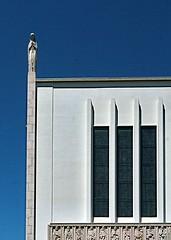 Modern Church Lines (john atte kiln) Tags: lisobon portugal lisbon lisboa white light lines windows stainedglass stark deliniated bassrelief sculpture statue religion church christianity bluesky sunny roof stonewalls shadows