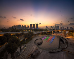 Barrage Rays (Scintt) Tags: singapore marina bay exposure sunset light evening dramatic surreal travel urban exploration buildings cityscape city skyline architecture offices business tanjong pagar central district cbd financial jon chiang photography scintillation scintt sky clouds residential sony a7r canon 17mm tse tilt shift hotel integrated resort casino exclusive tourism shopping mall property dusk wide angle residences banks field glow orange fiery sun pano panorama stitched water starburst lens flare barrage rays twilight epic crepuscular