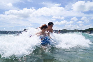Young couple enjoying in the sea