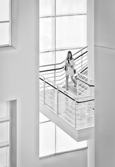 Girl On The Stairs (Inge Vautrin Photography) Tags: girl stairs walking down california ca usa blackandwhite bw hat monochrome mono people person steps streetphotography walls white windows