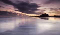 Bamburgh shadow. (Elidor.) Tags: bamburgh castle northumberland d90 eastcoast silhouette sunrise dawn christmas winter beach sea