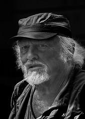 Portrait (D80_481907) (Itzick) Tags: denmark copenhagen candid bw blackbackground bwportrait beard portrait hat goatee whitehair streetphotography d800 itzick