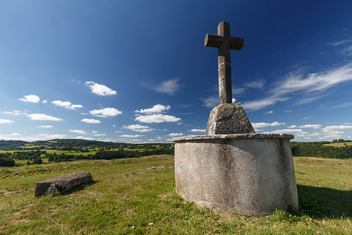 An old cross on top of a hill
