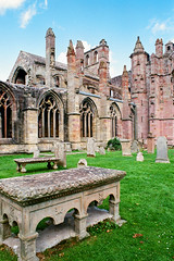 """Melrose (Peter Gutierrez) Tags: photo europe european europeans united kingdom uk great britain british brit brits scotland scottish scot scots borders melrose abbey cistercian monastery church heritage history historic old ancient medieval religious architecture christian gothic ruin ruins ruined stone stones grass square wall walls arch arches door film peter gutierrez """"peter gutierrez"""" unitedkingdom photograph photography cemetery"""