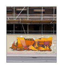 Street Art (Neist), East London, England. (Joseph O'Malley64) Tags: neist streetartist streetart urbanart publicart freeart graffiti eastlondon eastend london england uk britain british greatbritain art artist artistry artwork mural muralist wallmural hordings fencing constructionsite buildingsite woodenpanels scaffold scaffolding facade originalvictorianfacade poles knuckles planks aluminiumladder pavement blockpaving granitekerbing draincover tarmac zedracrossingproximitylines urban urbanlandscape aerosol cans spray paint fujix x100t accuracyprecision