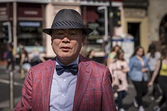 Gangnam Style (Leanne Boulton) Tags: people urban street candid portrait portraiture streetphotography candidstreetphotography candidportrait streetportrait eyecontact candideyecontact streetlife man male face facial expression look emotion feeling mood eyes sunlight summer hat mesh dapper style stylish fashion tourist tourism asian tone texture detail depthoffield bokeh naturallight outdoor light shade shadow city scene human life living humanity society culture canon canon5d 5dmkiii 70mm character ef2470mmf28liiusm color colour glasgow scotland uk