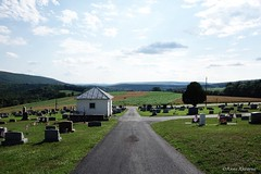 Beautiful Cemetery Views (Anne Ahearne) Tags: cemetery sky clouds mountain hills graveyard grave gravestone headstone