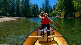 Cheryl Byng canoeing down the San Juan River, Port Renfrew, British Columbia, Canada