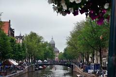 _DSC0300 (Ruben Mediavilla) Tags: holland amsterdam netherlands architecture travel arquitectura city building europe bridge dam canal water boat church trees