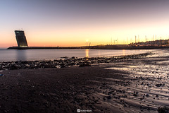 Lisbon sunset (HugoSilvaDesigns) Tags: sunset water brach rocks sand architecture tower sky sun river tejo lisbon lisboa canon 60d kitlens