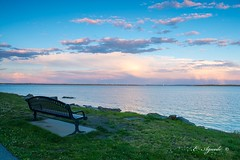 Bench (E. Aguedo) Tags: bench beach green sunset sky spring colors water warwick new england ngc clouds sea ocean