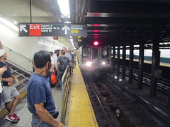 NYC Subway, 07/14/17: Friday evening rush-hour passengers get ready as a Coney Island-bound N train pulls into the Canal Street station (IMG_5305) (Gary Dunaier) Tags: mta metropolitantransportationauthority trains publictrasportation transportation commuting commuters nyc newyorkcity