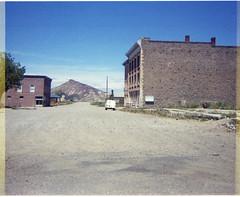 Goldfield, Nevada - Business District - 1968 (tonopah06) Tags: goldfield nevada esmeralda county nv 1968 miningcamp goldcampghost towncolumbiaavenueavemountainbank building cook js bank street