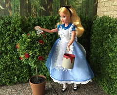 "8. ""Painting the Roses Red"" (Foxy Belle) Tags: doll disney alice wonderland diorama 1999 mattel outside scrapbook paper hedge queen maze paint roses red plants 1 16 playscale barbie can brush ooak craft make"