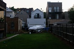 Side Yard and Boat (Josh Koonce) Tags: builtenvironment canon eos 70d canoneos70d sigma1750mmf28exdcoshsm sigma1750mmf28 aroundtown humboldtpark palmersquare backyard unseen storage boat covered evening chicago illinois summer2017 neighborhood dusk eos70d slr sigma sigma1750mmf28exdcoshsmfld dslr 1750mmf28exdcoshsm