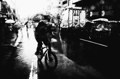 Cycling In The Rain (Meljoe San Diego) Tags: meljoesandiego ricoh ricohgr gr streetphotography street rain bicycle monochrome philippines