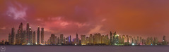 Awakening... (Charlie_Joe) Tags: uae dubai unitedarabemirates jumeirah dubaimarina jbr seascape architecture cityscape tallest tower longexposure skyline colours clouds sunrise fiery storm skyscraper drama outdoor weather silhouette panorama wide red