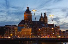 Amsterdam (alamsterdam) Tags: amsterdam people picture stnicolaschurch bridge cars evening trafficlights victoria hotel shops water architecture tower man woman sky clouds holland city