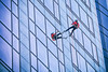Hanging Toe Touches (Ian Sane) Tags: ian sane images hangingtoetouches rappelforher2017 girlsinc woman rappelling 1000 broadway building downtown portland oregon candid street photography reflection rope canon eos 5ds r camera ef70200mm f28l is usm lens