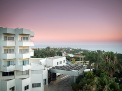 Hotel View (Howie Mudge LRPS BPE1*) Tags: hotel building architecture trees buildings sky sea water scene scenery scenic views vista evening sunset goldenhour coralbay cyprus holiday vacation travel travelling traveller olympus olympusuk olympusem5markii em5mkii £micro four thirdsmftm43compact system cameramirrorless camera olympusm14150mmf4056ii