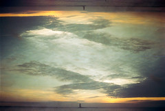 Only The Smallest Differences Seperate Dimensions (thomas_anthony__) Tags: film 35mm kodak portra 400 iso canon a1 multiple double exposure horizon horizons sea ocean bay water sky clouds skyporn blue orange dusk sunset nature dream dimension reflection reflections lighthouse light house mirrored