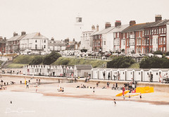 Traditional English Seafront At Southwold, Suffolk (Peter Greenway) Tags: seaside flickr beach southwold suffolk lighthouse beachhuts seafront seasideport