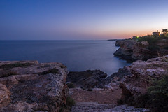 Mallorca evening (Jens Haggren) Tags: sea water rocks sky colours longexposure lights view landscape nature mallorca spain jenshaggren