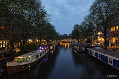 Amsterdam. (alamsterdam) Tags: amsterdam brouwersgracht canal evening longexposure reflection boats swans sky clouds bridges bikes cars