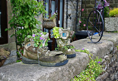 Recycled... (Blue sky and countryside) Tags: old boots flowers comical attractive dry stone wall elton village peak district national park england pentax