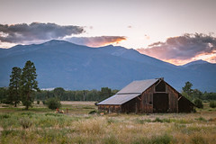 Montana countryside (michaelraleigh) Tags: 50mm landscape sunset serene mountains canon countryside abandoned barn secluded shed sky outdoors country montana f18 canoneos5dmarkii mountain