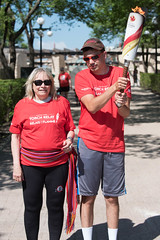 Mona Buors hand off to Michael Milani (2017 Canada Games // Jeux du Canada 2017) Tags: keithlevitphotography monabuors michaelmilani canadasummergames tor winnpegtorchrelay