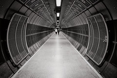 Ugly Truth (Douguerreotype) Tags: futuristic monochrome underground gate city bw station 2 uk metro metal england british blackandwhite mono architecture britain subway london gb tunnel urban people tube