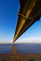 Up and under. (alan.irons) Tags: humberbridge humberside humber estuary bluesky bridge suspension shoreline canoneos1dxmkll