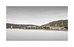Recluse (GlennDriver) Tags: black bw long exposure france river mono europe bridge no colour church canon wine vineyards water