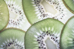 Textures of Kiwi (DarrenCowley) Tags: macromondays texture kiwi seed macro backlit slice layer green fruit
