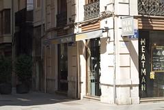 Meet the Meat Man (Riccardo Mori) Tags: valencia nikon d200 micronikkor street restaurant shadow lettering type door window balcony