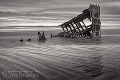 Wreck of Peter Iredale B+W (Jerry Fornarotto) Tags: abandoned bw beach blackandwhite boat clouds coast decay disaster dramatic historical iredale iron jerryfornarotto landscape longexposure moody northwest oceansunset old oldship oregon oregoncoast outdoors pacific pacificnorthwest peteriredale reflection remains ruins rust rusted scene sea ship shipwreck shore skeleton sky steel storm sunset travel vessel warrenton water waves west western wm wreck