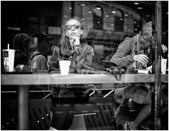 Untitled (Steve Lundqvist) Tags: sweden svezia sverige stoccolma stockholm summer jeans young youth gioventù nikon street streetphotography timing time people dinner lunch meal reflection glass portrait candid