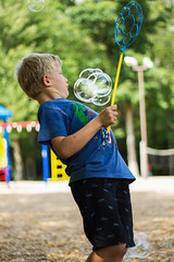 Close Call (Skyelyte) Tags: bubbles boy grandson playing park petersonpark wolcottconnecticut fun candid candidshot